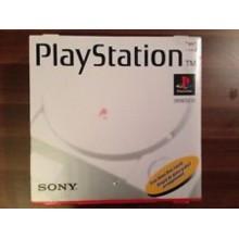 Console Playstation 1 en boîte.